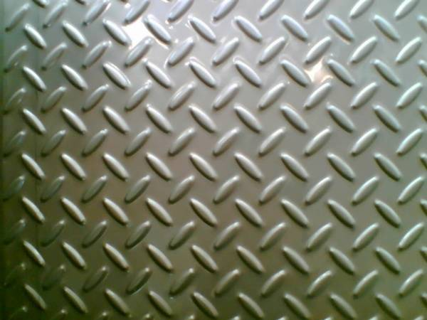 a piece of stainless steel checker plate with big rice projections